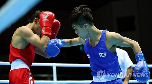 (آسياد) الملاكم شين جونغ هون يفوز بالميدالية الذهبية في وزن الذبابة