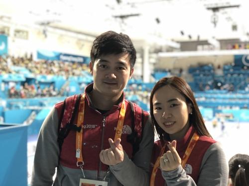 韩中冰壶夫妇同为平昌冬残奥助力