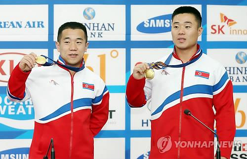 (Asiad) N. Korean lifters dedicate victories to young leader