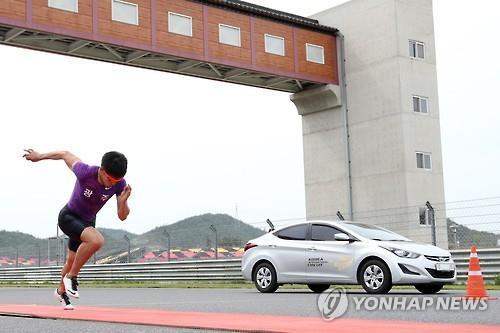 Car edges out S. Korean sprinter in 70m race