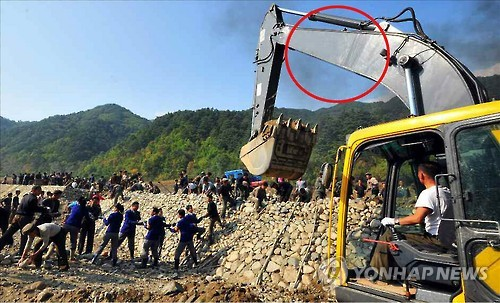 N. Korea covers brand names of equipments in flood-restoration reports