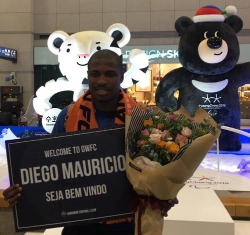 Newly promoted football club signs Brazilian forward