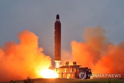 (LEAD) (News Focus) N. Korea fires intermediate-range missile to test Trump