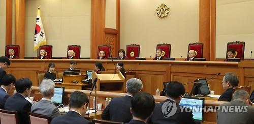 Park asks court to delay impeachment trial