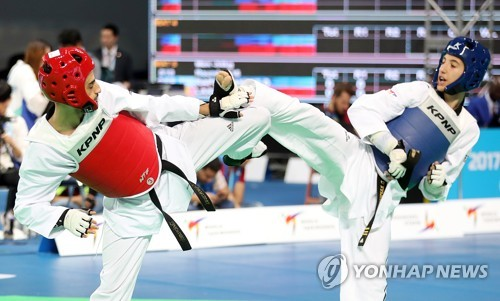 (LEAD) Taekwondo's world championships open with preliminary action
