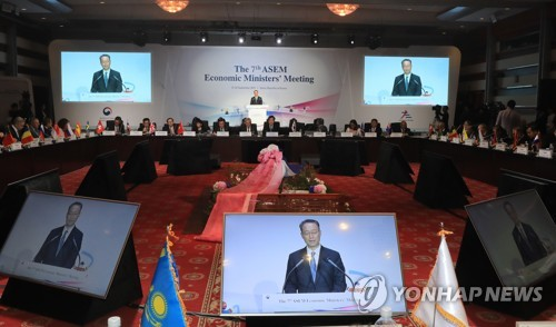 (LEAD) ASEM ministerial meeting advocates free trade, tech cooperation