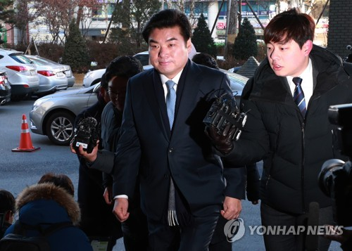 Opposition lawmaker faces trial for suspected bribery, illegal political fund