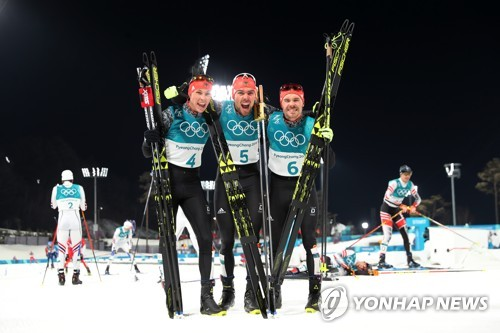 (LEAD) (Olympics) Germans complete podium sweep in Nordic combined large hill event