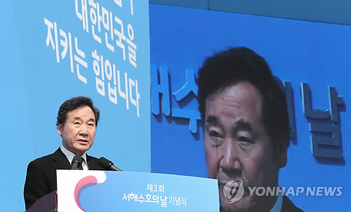 Prime minister vows strong defense against North Korea despite conciliatory mood