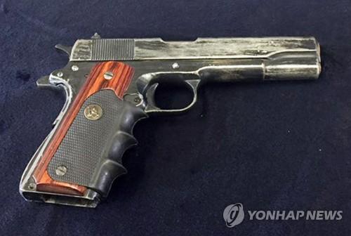 권총 출처는 오리무중…농협 강도사건 조기에 일단락