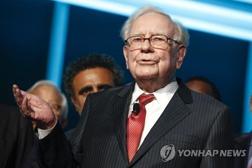 """버핏 """"다우 100년내 100만"""" vs 블룸버그 """"주가상승 이해 안돼"""""""