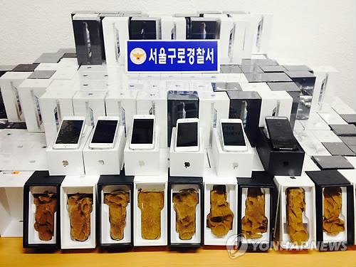 '찰흙 아이폰'에 4억 사기당한 전당포들…아이폰 대신 흙 상자