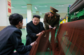 Kim Jong-un at fishing gear factory