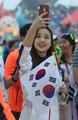 Son Yeon-jae takes selfie at Universiade closing