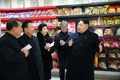 N.K. leader inspects foodstuff plant for athletes