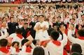 N.K. leader watches children's performance