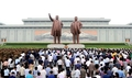 N. Koreans pay tribute to former leaders