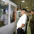 N.K.'s Kim visits machine plant