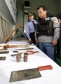 Ruling party leader inspects Chinese fishermen's weapons