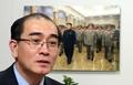 Thae Yong-ho devant une photo du dirigeant nord-coréen