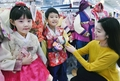 Costumes traditionnels à l'approche du Nouvel An lunaire