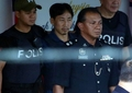 Suspect in half brother's murder deported