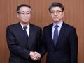 El enviado nuclear surcoreano con su homólogo chino