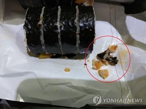 편의점 김밥 속 어금니는 '치아 충전재'…뜨거워진 진실 공방