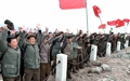 N.K. party workers climb symbolic mountain