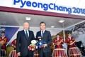 Devant le stand de promotion de PyeongChang