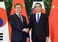 Moon avec le PM chinois