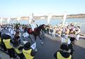 La antorcha olímpica a caballo