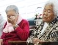 外相会見を視聴する慰安婦被害者