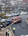 Traffic snarl over fallen power pole