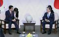 会談する韓日首脳
