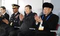 Delegados norcoreanos en la ceremonia de clausura