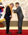 Moon awards IOC chief with highest sport merit decoration