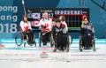 Curling en fauteuil