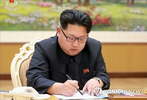 North Korea`s top leader Kim Jong-un signs an order for the country to conduct a hydrogen bomb test in this photo published by the North`s Korean Central News Agency on Jan. 6, 2016. Pyongyang claimed a successful H-bomb test in a special broadcast, saying it occurred at 10 a.m. on the day. The announcement was made within hours after what looked like an artificially created earthquake was detected in the North`s eastern region near its nuclear test site. (Yonhap)