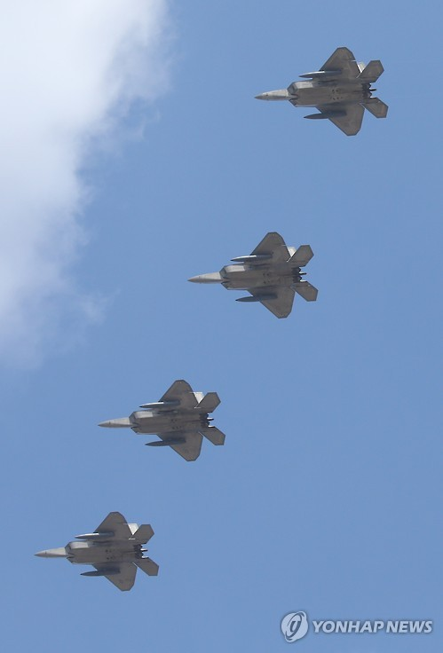 Four U.S. Air Force F-22 Raptors soar above Osan Air Base, south of Seoul, on Feb. 17, 2016. The deployment of the four F-22 Raptor stealth jets to South Korea marked the latest show of force by South Korea and the United States against North Korea, which conducted its fourth nuclear test on Jan. 6 and launched a long-range rocket on Feb. 7, denounced by the outside world as a test of ballistic missile technology. (Yonhap)