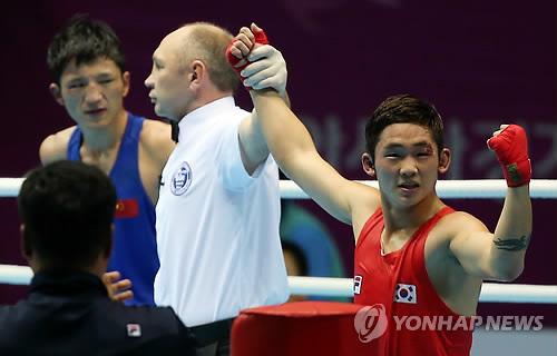 Le boxeur sud-corテゥen Ham Sang-myeong