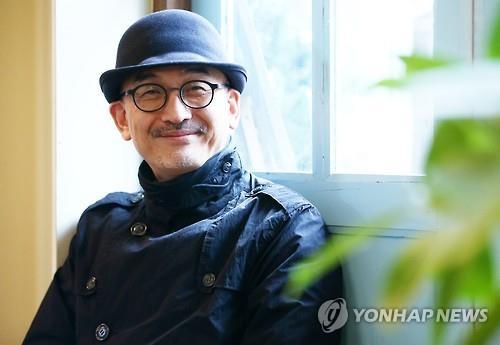イ・ジュンイク監督=12日、ソウル(聯合ニュース)