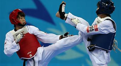 اللاعبة الكورية الجنوبية لي آه روم تفوز بالميدالية في سباق التايكوندو