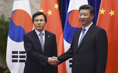 China's Xi says Beijing will not recognize N. Korea's nuclear policy