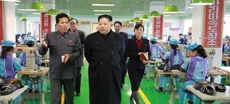 N. Korean leader visits shoes factory