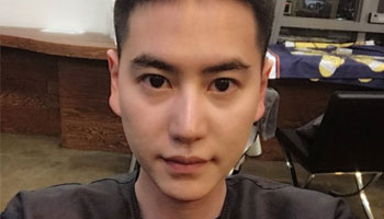 Super Junior's Kyuhyun begins military service