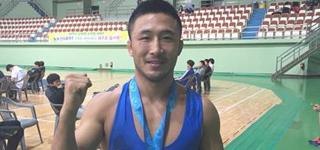(Interview Yonhap) Un ancien partenaire d'entraînement de lutte participe enfin aux JO