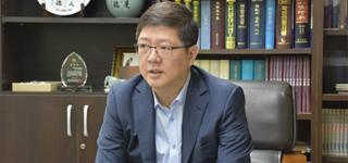 El jefe del cuerpo de cooperación intercoreana subraya los intercambios del sector privado