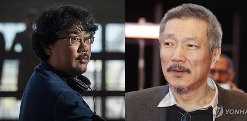 导演奉俊昊(左)和洪尚秀(韩联社)