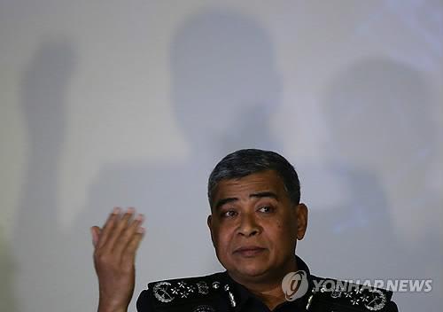 资料图片:2月22日,马来西亚警察总长哈立德・阿布・巴卡尔举行记者会,介绍金正男遇害案相关情况。(韩联社/欧新社)